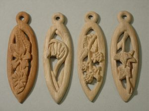 wooden pendants carved using a knife