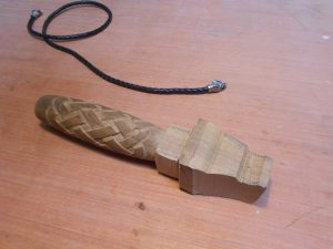 carving a wooden knife handle