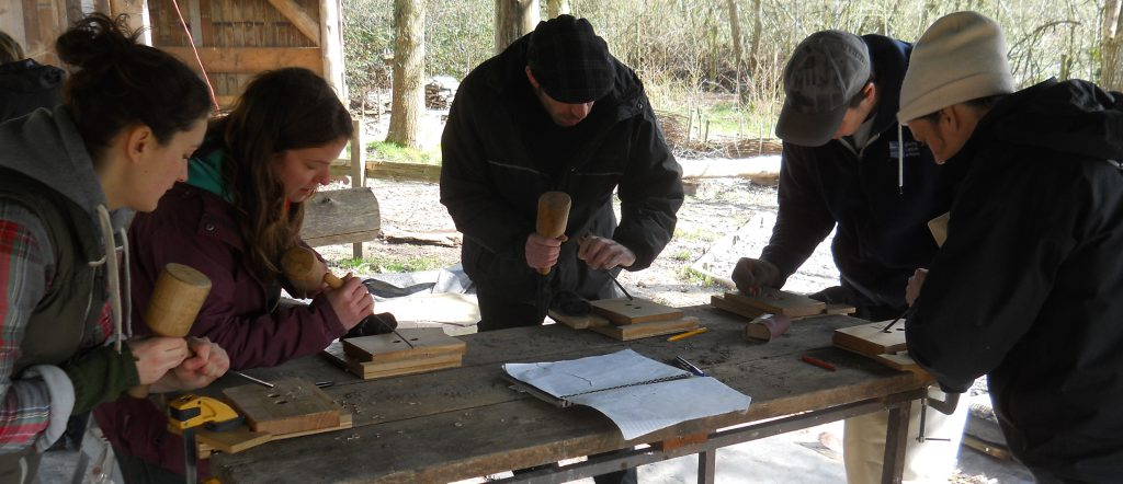 Woodcarving with an adult group at Tree life centre, Bristol