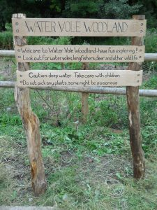 Carved wooden signs for community groups