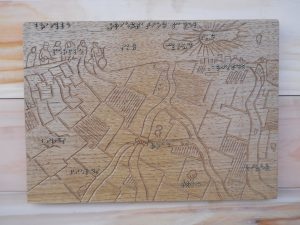 braille on woodcarving