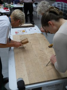 woodcarving the braille panel at Southmead hospital