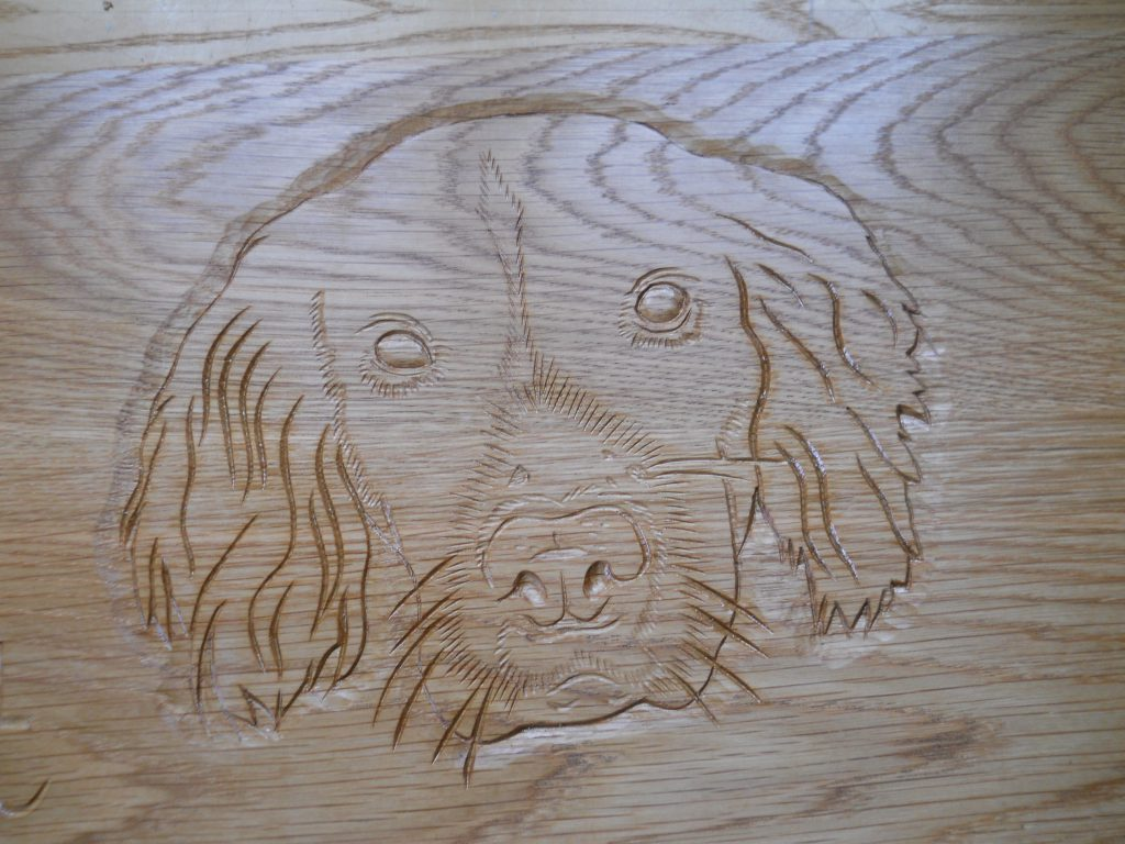 Wood carving of dog