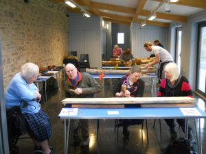 teaching woodcarving to adults and young people for LinkAge
