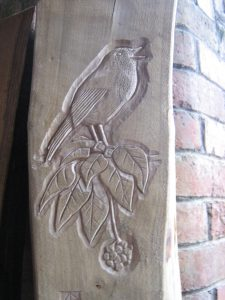 carved robin and ivy