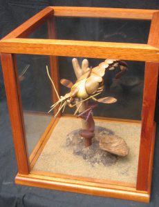 unusual woodcarving of a crustacean inspired by Erik Satie