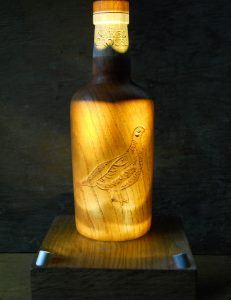Naked grouse oak whiskey bottle