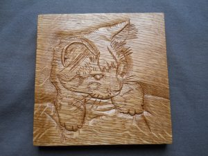 wood carving portrait cat