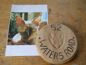 Carved portrait of a pet cat in wood