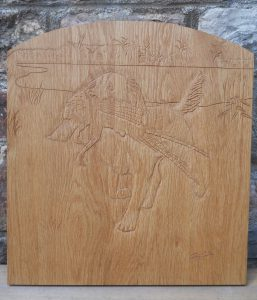 carving of gun dog